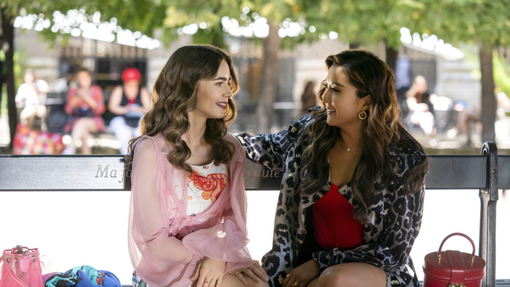 Lily Collins as Emily, Ashley Park as Mindy in Emily in Paris