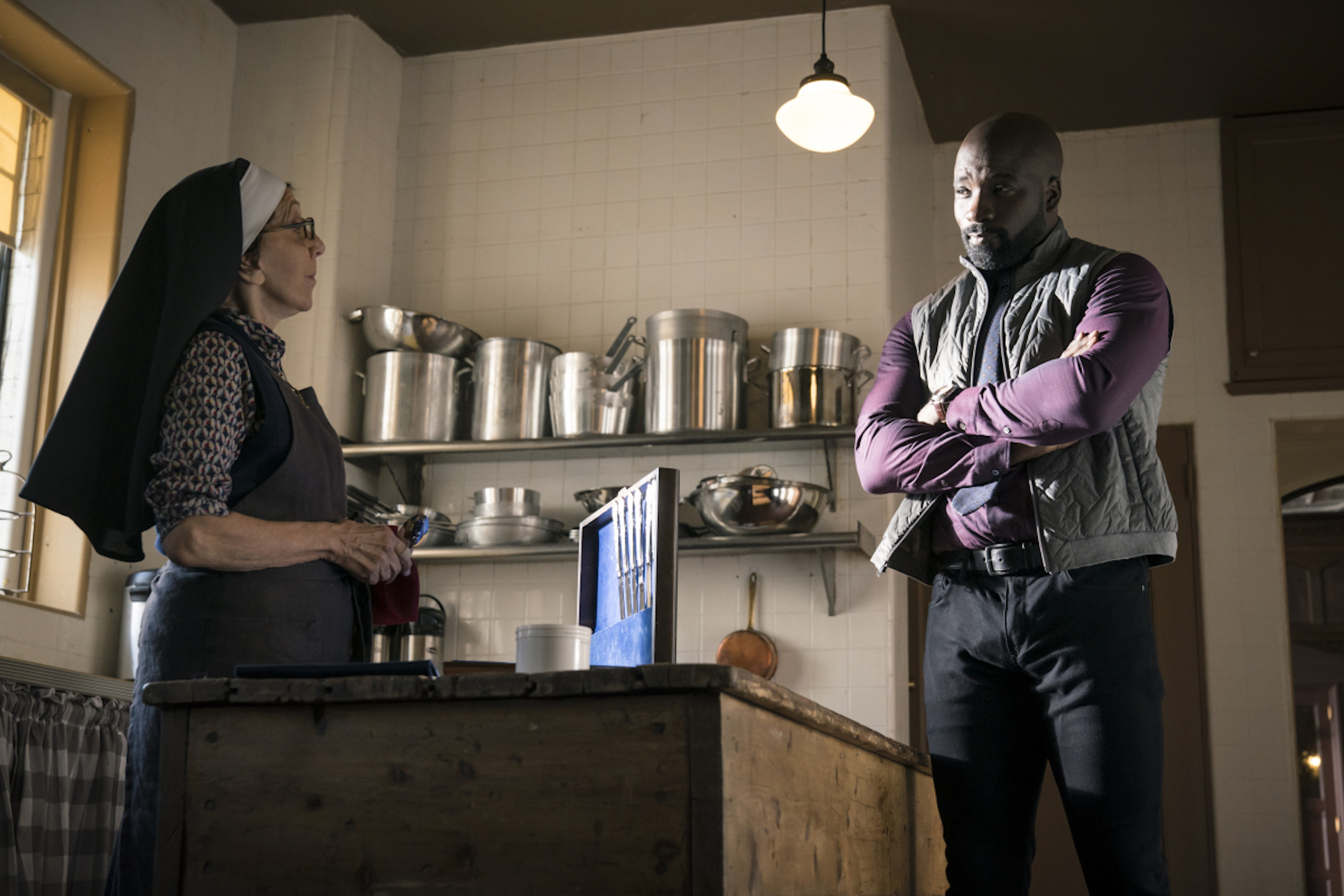 Andrea Martin as Sister Andrea, Mike Colter as David in Evil